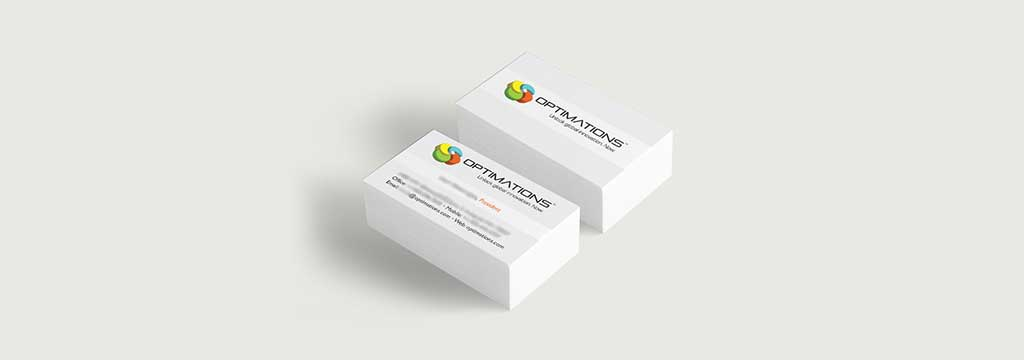 Two stacks of Optimations business cards